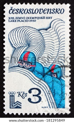CZECHOSLOVAKIA - CIRCA 1980: a stamp printed in the Czechoslovakia shows Four-man Bobsled, 13th Winter Olympic Games, Lake Placid, New York, circa 1980 - stock photo