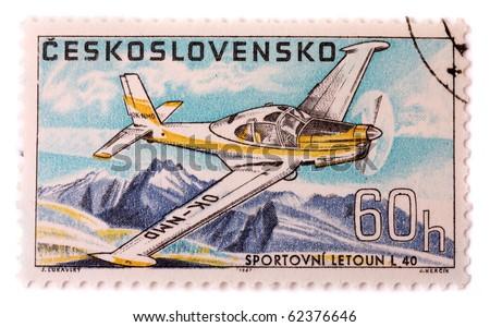 CZECHOSLOVAKIA - CIRCA 1967: A stamp printed in The Czechoslovakia shows image famous aerobatic plane Zlin L 40, series, circa 1967 - stock photo