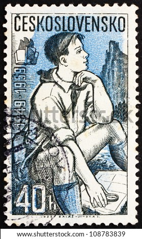 CZECHOSLOVAKIA - CIRCA 1959: a stamp printed in the Czechoslovakia shows Pioneer Studying Map, circa 1959 - stock photo