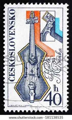 CZECHOSLOVAKIA - CIRCA 1974: a stamp printed in the Czechoslovakia shows Violin, by Martin Benka, Prague and Bratislava Music Festivals, circa 1974 - stock photo