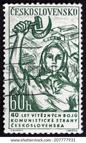 CZECHOSLOVAKIA - CIRCA 1961: a stamp printed in the Czechoslovakia shows Woman with Hammer and Sickle, circa 1961 - stock photo