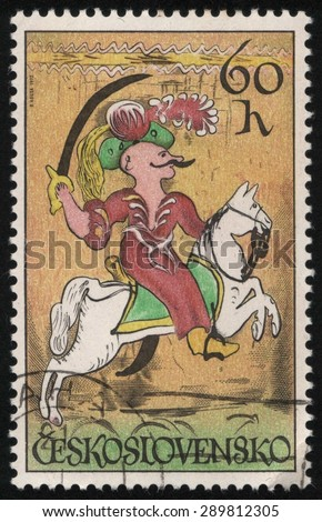 CZECHOSLOVAKIA - CIRCA 1972: A used postage stamp printed in Czechoslovakia from the â??Horsemanship, Ceramics and Glassâ? issue, shows a Turkish Janissary on a white horse.  - stock photo