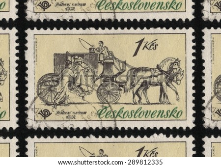 CZECHOSLOVAKIA â?? CIRCA 1981: A used postage stamp printed in Czechoslovakia from the â??Historic Coaches in Postal Museumâ? issue, shows people boarding a stage coach pulled by horses.  - stock photo