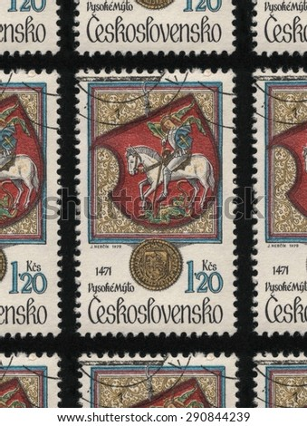 "CZECHOSLOVAKIA - CIRCA 1979: A used postage stamp printed in Czechoslovakia from the ""Animals in Heraldry"" issue, showing Vysoke Myto (St. George and the Dragon).  - stock photo"