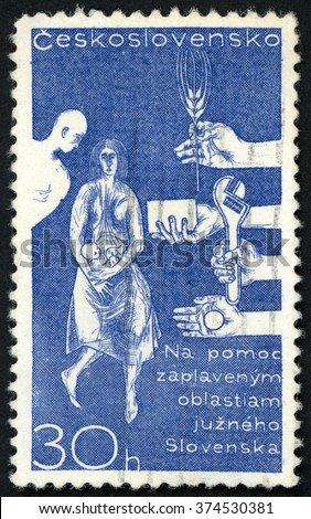 CZECHOSLOVAKIA - CIRCA 1965: post stamp printed in Ceskoslovensko shows help for Danube flood victims in Slovakia; Scott 1337 A513 30h blue, circa 1965 - stock photo