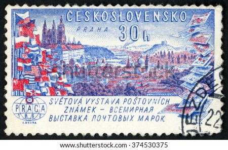 CZECHOSLOVAKIA - CIRCA 1961: post stamp printed in Ceskoslovensko shows view of Prague, flags and stamps; PRAGA world exhibit of postage stamps; Scott 1071 A415 30h red blue, circa 1963 - stock photo