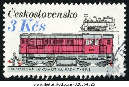CZECHOSLOVAKIA - CIRCA 1986: post stamp printed in former Czechoslovakia (Ceskoslovensko) shows diesel locomotive T466.2, locomotives and streetcars; Scott 2628 A941 3k; circa 1986 - stock photo