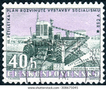 CZECHOSLOVAKIA - CIRCA 1960: Postage stamp printed in Czechoslovakia, Issued to publicize the new five-year plan, shows Harvester, circa 1960 - stock photo