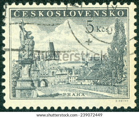 CZECHOSLOVAKIA - CIRCA 1953: Postage stamp printed in Czechoslovakia shows Prague - Charles Bridg, statue of St. Luitgard by Matthias Braun and Prague Castle, circa 1953 - stock photo