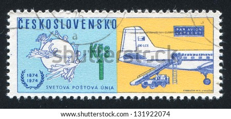 CZECHOSLOVAKIA - CIRCA 1974: stamp printed by Czechoslovakia, shows Universal Postal Union Emblem and Czechoslovak Airlines mail plane, circa 1974