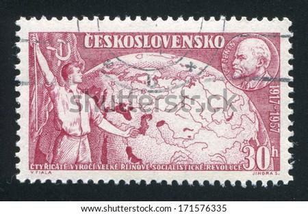 CZECHOSLOVAKIA - CIRCA 1957: stamp printed by Czechoslovakia, shows Worker, globe and Lenin, circa 1957 - stock photo