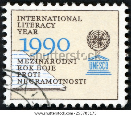 CZECHOSLOVAKIA - CIRCA 1990: stamp printed in Czechoslovakia (Ceska) shows part of lined notebook and UNESCO emblems; UNESCO world literacy year; Scott 2770 A998 1k; circa 1990 - stock photo