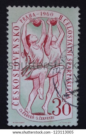 CZECHOSLOVAKIA - CIRCA 1960: Stamp printed in former Czechoslovakia commemorates ball exercises of 2nd National Spartakiad in Prague in 1960, circa 1960.