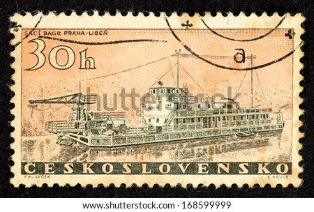 CZECHOSLOVAKIA - CIRCA 1958: Stamps printed in Czechoslovakia with image of a suction dredger boat built by Praha-Liben, circa 1958.  - stock photo
