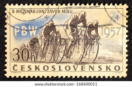 CZECHOSLOVAKIA - CIRCA 1957: Stamps printed in Czechoslovakia with image of racer cyclists to commemorate the 10th International Peace Race, circa 1957.  - stock photo