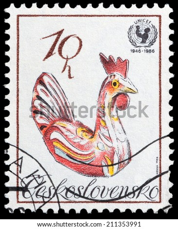 CZECHOSLOVAKIA - CIRCA 1986: The stamp printed in Czechoslovakia shows a folk rooste, circa 1986 - stock photo