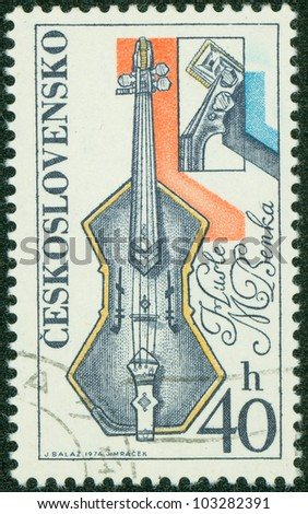 CZECHOSLOVAKIA - CIRCA 1974: The stamp printed in Czechoslovakia shows a violin, circa 1974 - stock photo