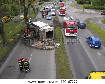 CZESTOCHOWA; POLAND - APRIL 30: Road accident in Czestochowa. Traffic accident April 30, 2014 in Czestochowa, Poland. Car for the dumping of garbage lying on the road. - stock photo