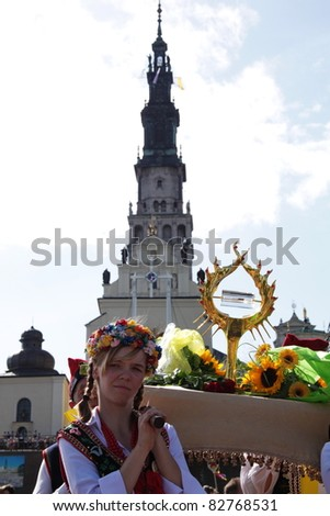 CZESTOCHOWA, POLAND - AUG 11 : unidentified Cracow pilgrims dressed in traditional costumes carry the Pope John Paul's II relic (blood) to the Jasna Gora Sanctuary on august 11, 2011 in Czestochowa, Poland - stock photo