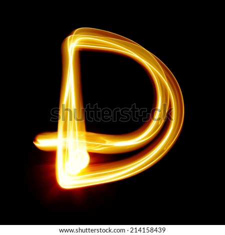 D - Created by light alphabet over black background - stock photo