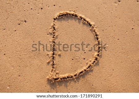 D text written in the sandy on the beach - stock photo