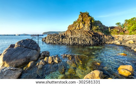 Da Dia Reef early sun on the stone path to the Giants Causeway beside the boats have yet to wake up - stock photo