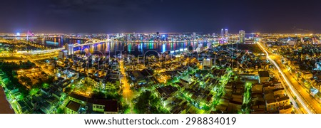 Da Nang city panorama at night with the lights flooded the city, is adorned with light bridges around Da Nang making more night life. This is considered as the best tourist city for foreign visitors