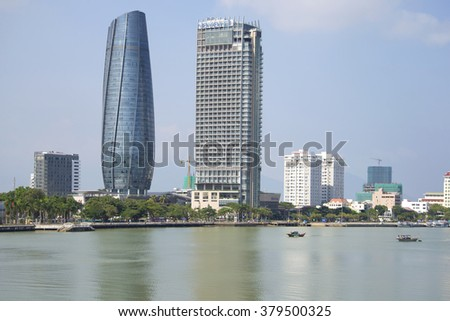 DA NANG, VIETNAM - JANUARY 06, 2016: The Han river and two high-rise buildings. Skyline of Da Nang