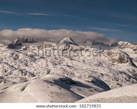 Dachstein mountain summit in sunny winter day (View from Krippenstein Austria) - stock photo