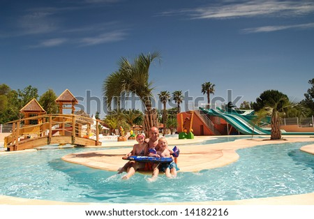 Dad and children having fun on the swimming pool - stock photo