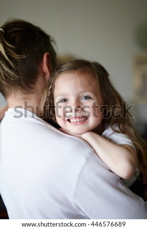 Dad and daughter hugging - stock photo
