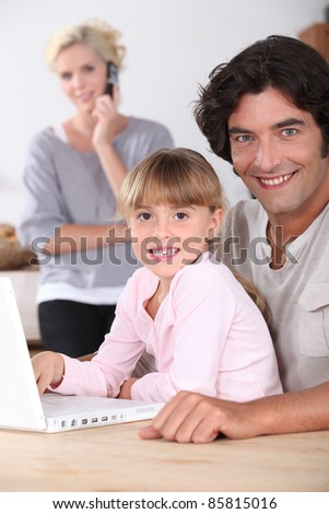 Dad and daughter using a laptop