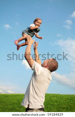 Dad and his little daughter having fun