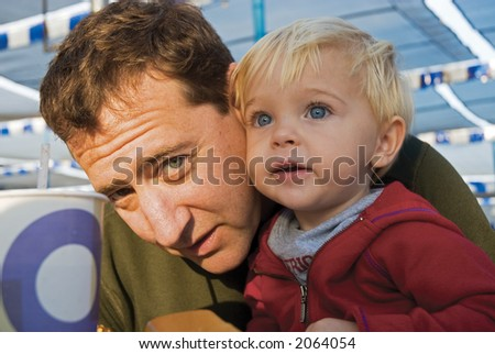 dad and his son together and smiling - stock photo