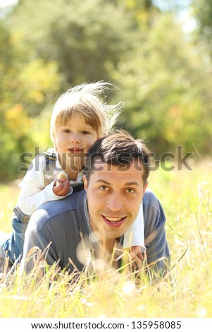 Dad and little daughter on nature