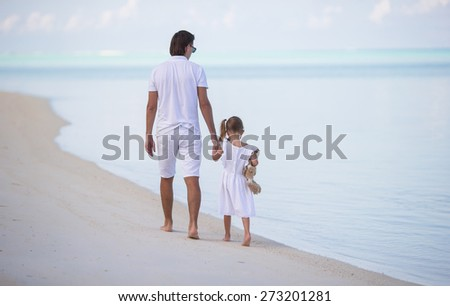 Dad and little girl with plush toy during summer vacation - stock photo