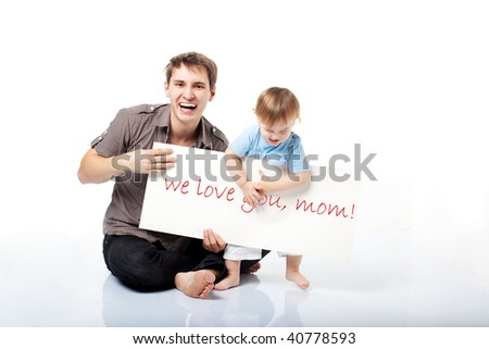 dad and little son making a declaration of love to their mom - stock photo