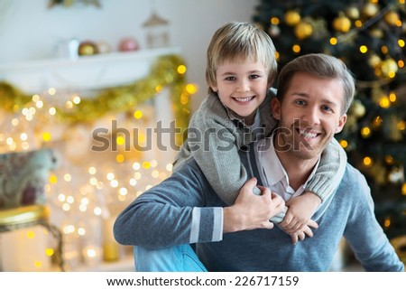 Dad and son at home - stock photo