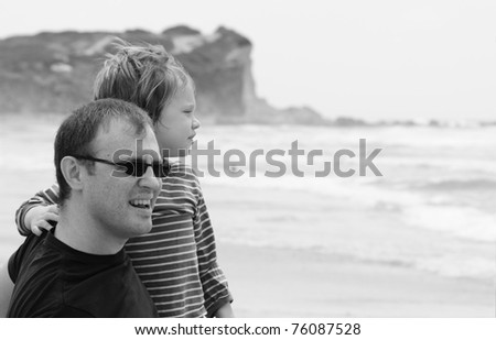 Dad and son at sea, black and white photo - stock photo