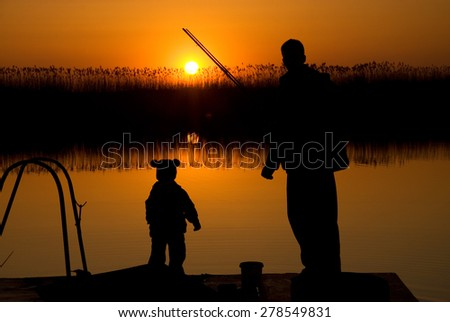 Dad and son fishing - stock photo