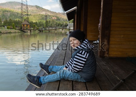 Dad and son on fishing. Family weekend leisure. Family fishing at the lake. - stock photo