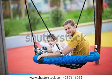 Dad and son on the playground