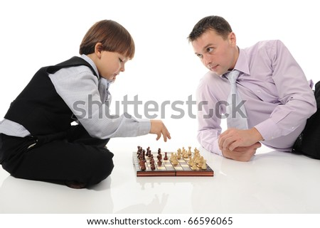 Dad and son playing chessin a bright room. Isolated on white background - stock photo