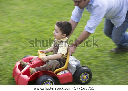 Dad And Son Playing With Toy Outdoors - stock photo