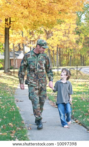 Dad and Son Walking - stock photo