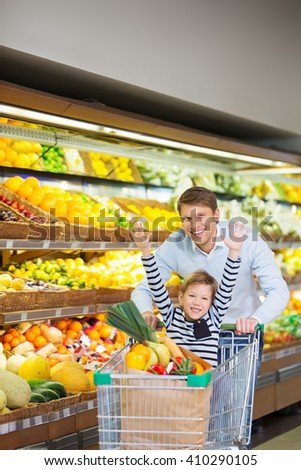 Dad and son with cart - stock photo