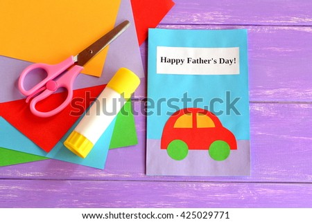 Dad greeting card. Happy dad's day greeting card. Happy father's day wishes. Children's handmade paper crafts. Father's day crafts for kids. Sheets of colored paper, kid scissors, glue - stock photo