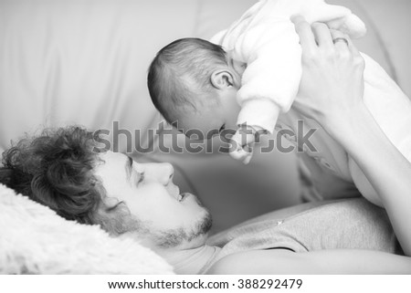 dad holding a small child. father and baby. black and white - stock photo