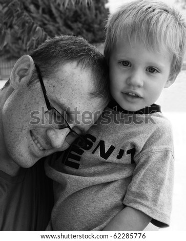 Dad hugging his son, black and white picture - stock photo