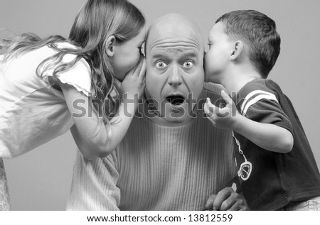 Dad looking surprised at news from kids - stock photo
